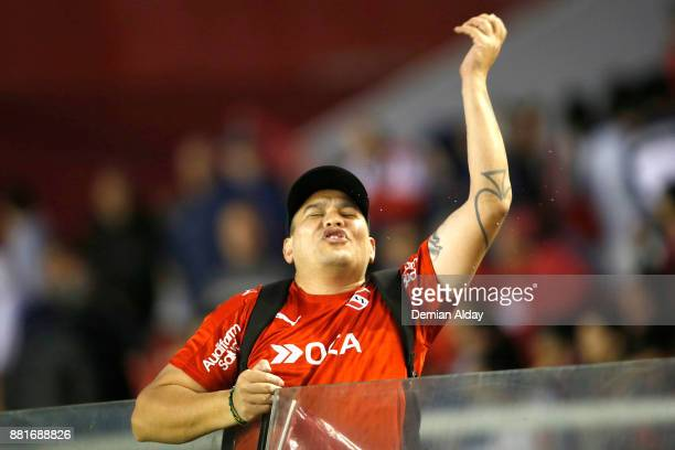 A fan of Independiente cheers for his team during a second leg match between Independiente and Libertad as part of the semifinals of Copa CONMEBOL...