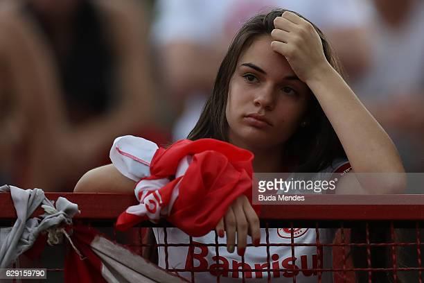 A fan of Internacional cries during a match between Fluminense and Internacional as part of Brasileirao Series A 2016 at Giulite Coutinho Stadium on...