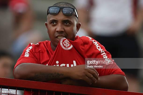 A fan of Internacional reacts during a match between Fluminense and Internacional as part of Brasileirao Series A 2016 at Giulite Coutinho Stadium on...
