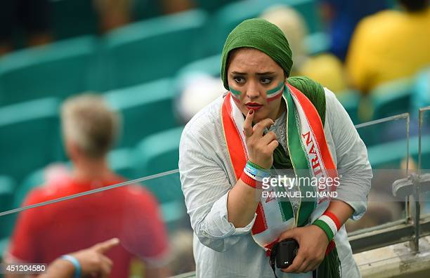 A fan of Iran gestures before a Group F football match between BosniaHercegovina and Iran at the Fonte Nova Arena in Salvador during the 2014 FIFA...