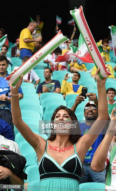 A fan of Iran smiles before a Group F football match between BosniaHercegovina and Iran at the Fonte Nova Arena in Salvador during the 2014 FIFA...