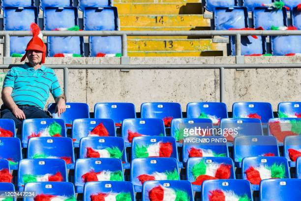 Fan of Italy waits prior to the Six Nations international rugby union match between Italy and Scotland at the Olympic stadium in Rome on February 22,...