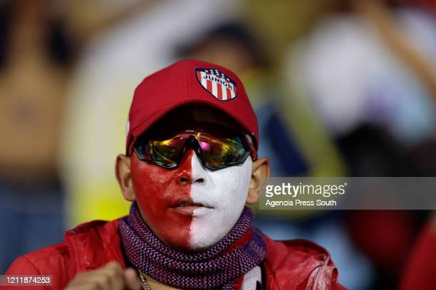 Fan of Junior with his face painted looks on prior to a Group A match between Independiente del Valle and Junior as part of Copa CONMEBOL...