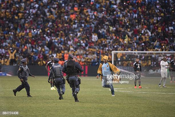A fan of Kaiser Chiefs enters field as he celebrates the victory during 2016 Carling Black Label Cup between Kaizer Chiefs FC and Orlando Pirates at...