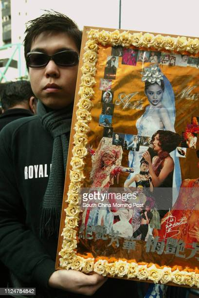 Fan of late Anita Mui Yim-fong displays his pictorial tribute outside Hong Kong Funeral Home in North Point. The cancer-stricken Canto-pop star Anita...