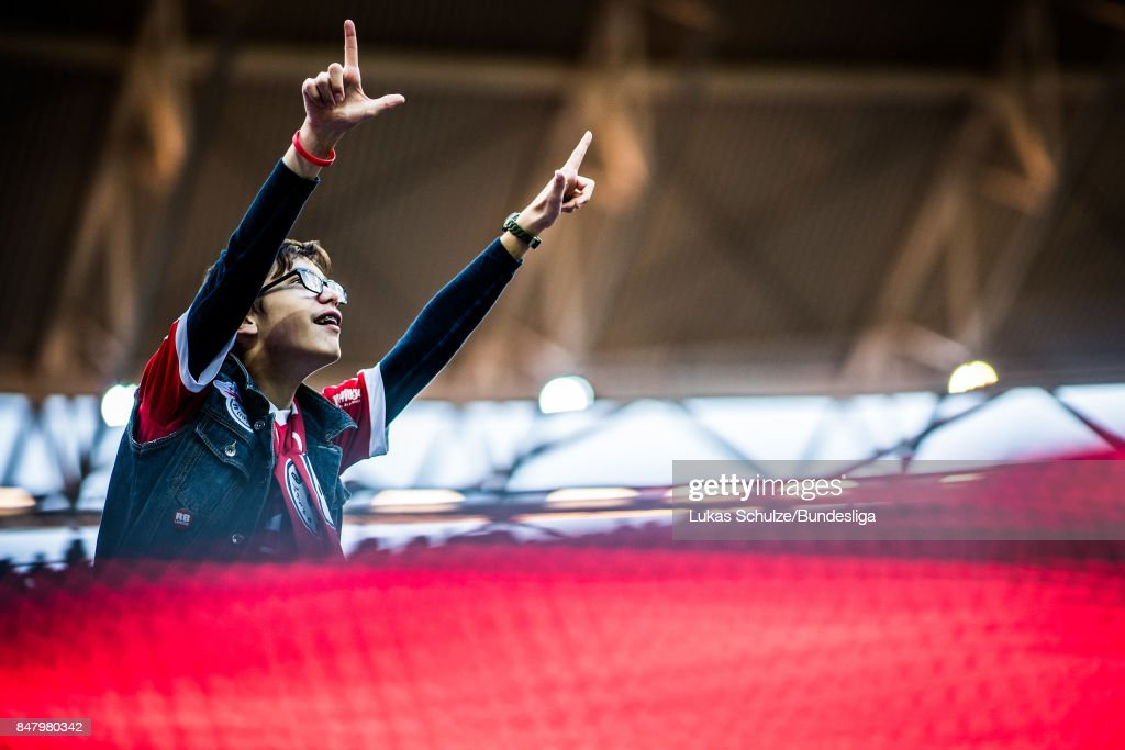A fan of Leipzig celebrates during the Bundesliga match between RB Leipzig and Borussia Moenchengladbach at Red Bull Arena on September 16, 2017 in Leipzig, Germany.