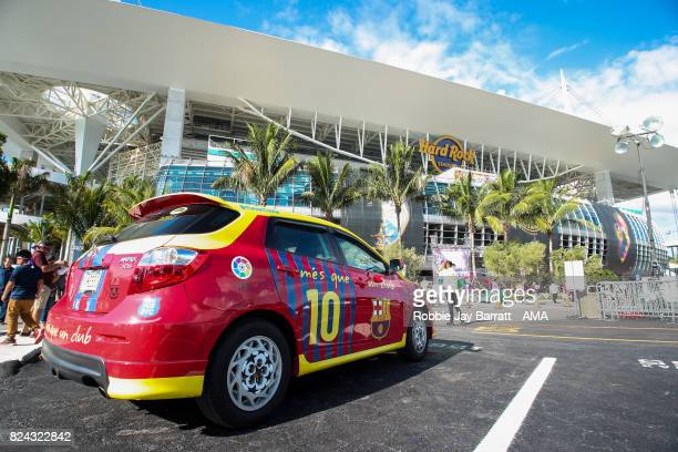 A fan of Lionel Messi of FC Barcelona has a car personalised outside Hard Rock Stadium home stadium of Miami Dolphins prior to the International...