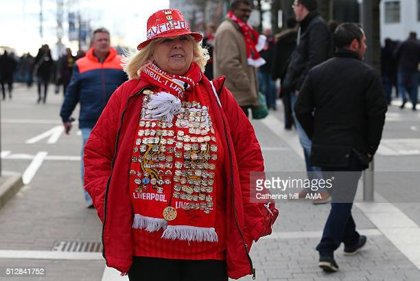 A fan of Liverpool wearing pin badges the Capital One Cup Final match between Liverpool and Manchester City at Wembley Stadium on February 28 2016 in...
