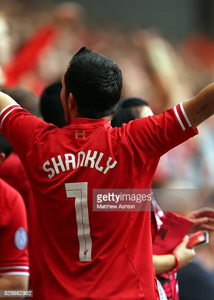 A fan of Liverpool with SHANKLY on the back of his shirt celebrating the former manager Bill Shankly