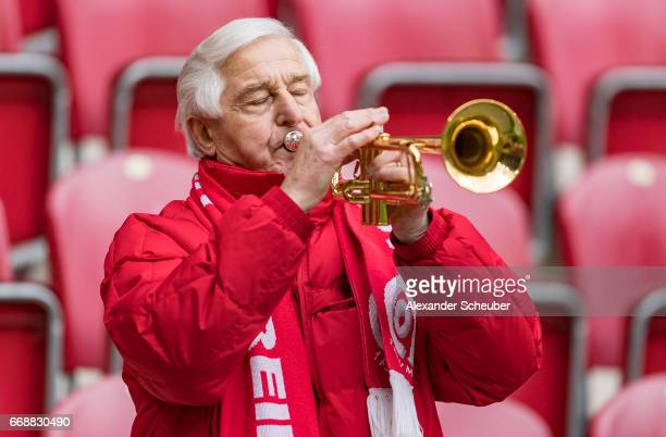 A fan of Mainz 05 plays the trumpet during the Bundesliga match between 1 FSV Mainz 05 and Hertha BSC at Opel Arena on April 15 2017 in Mainz Germany