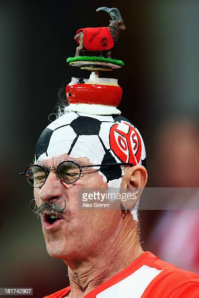 A fan of Mainz looks on prior to the DFB Cup second round match between 1 FSV Mainz 05 and 1 FC Koeln at Coface Arena on September 24 2013 in Mainz...