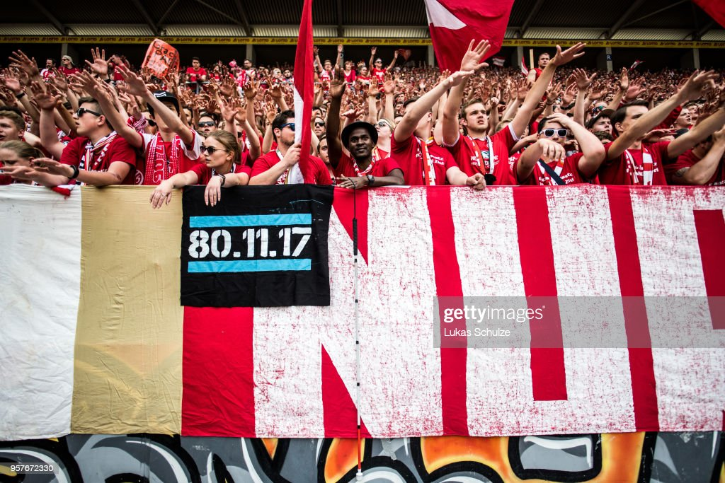 A fan of Mainz with a white cane celebrates with other fans after the Bundesliga match between 1. FSV Mainz 05 and SV Werder Bremen at Opel Arena on May 12, 2018 in Mainz, Germany.