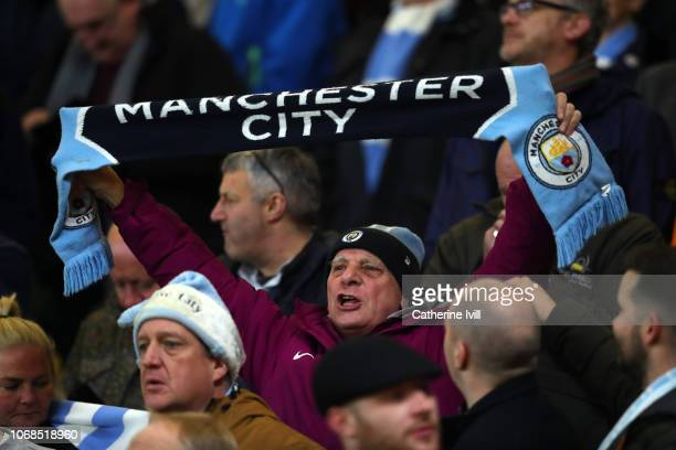 A fan of Manchester City during the Premier League match between Watford FC and Manchester City at Vicarage Road on December 4 2018 in Watford United...