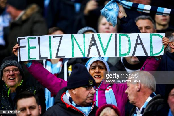 A fan of Manchester City holds up a banner reading Feliz Navidad during the Premier League match between Manchester City and Crystal Palace at Etihad...