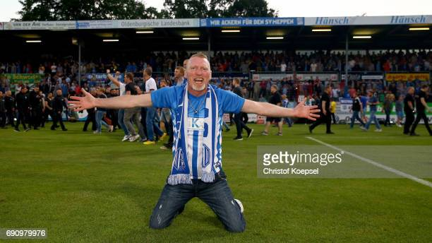 A fan of Meppen celebrates after winning 43 after penalty shootout the Relegation Regionalliga Play Off second leg match at Hensch Arena on May 31...