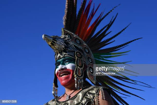 A fan of Mexico arrives at the stadium for the 2018 World Cup qualifier football match between Mexico and Trinidad and Tobago in San Luis Potosi...
