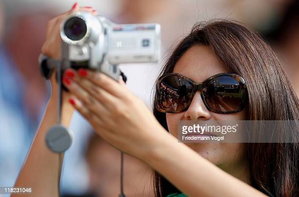 A fan of Mexico filming during the FIFA Women's World Cup 2011 Group B match between New Zealand and Mexico at RheinNeckar Arena on July 5 2011 in...