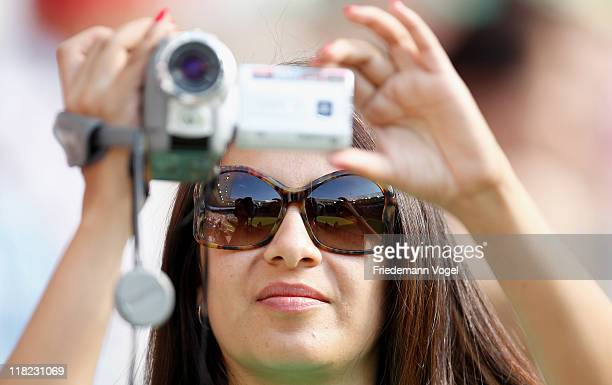 A fan of Mexico films during the FIFA Women's World Cup 2011 Group B match between New Zealand and Mexico at RheinNeckar Arena on July 5 2011 in...