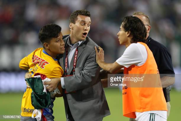 Fan of Mexico goes down to the field to take picture with Diego Lainez during an international friendly match between Mexico and United States at...