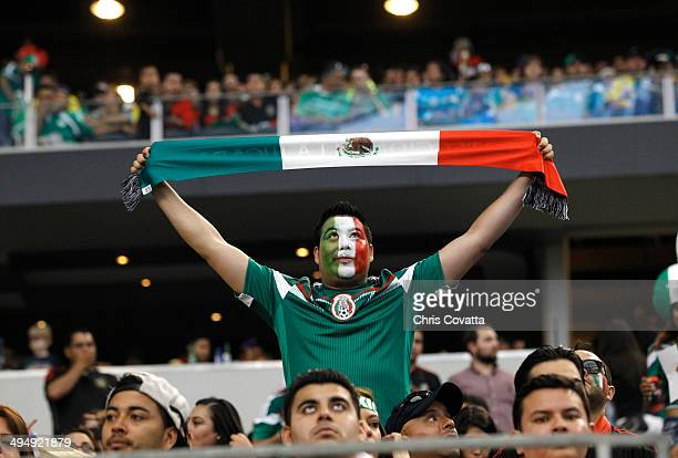 A fan of Mexico holds the flag as his team plays Ecuador in a international friendly match at the ATT Stadium on May 31 2014 in Arlington Texas