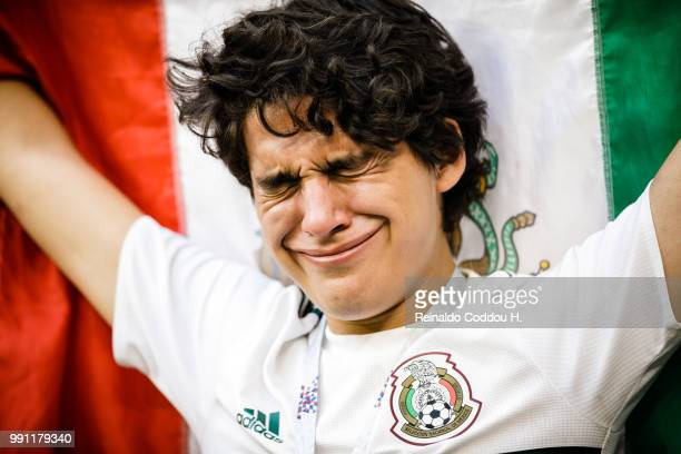 Fan of Mexico looks dejected after the elimination following the 2018 FIFA World Cup Russia Round of 16 match between Brazil and Mexico at Samara...