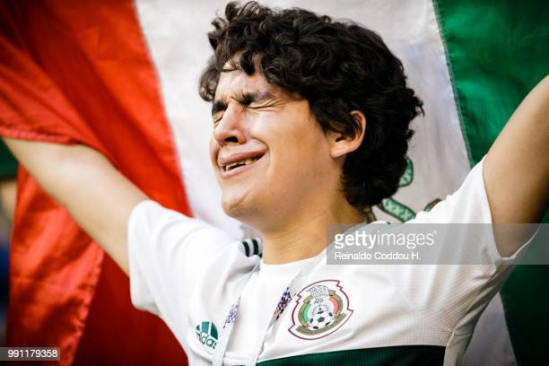A fan of Mexico looks dejected after the elimination following the 2018 FIFA World Cup Russia Round of 16 match between Brazil and Mexico at Samara...