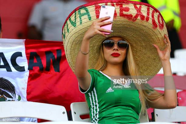 A fan of Mexico poses for a selfie prior the fifth round match between Trinidad Tobago and Mexico as part of the FIFA 2018 World Cup Qualifiers at...