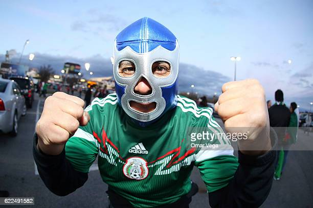 A fan of Mexico wearing a Blue Demon mask poses for photos outside the satadium prior the match between USA and Mexico as part of FIFA 2018 World Cup...