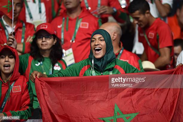 A fan of Morocco's Mohammed Rabii cheers as he's announced the winner against Kenya's Rayton Nduku Okwiri during the Men's Welter match at the Rio...