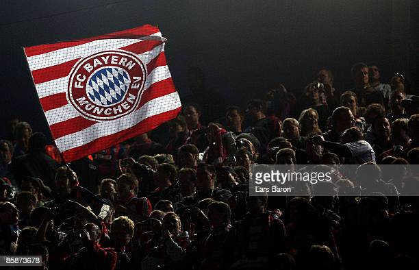 A fan of Munich waves a flag during the UEFA Champions League quarter final first leg match between FC Barcelona and FC Bayern Munich at the Camp Nou...