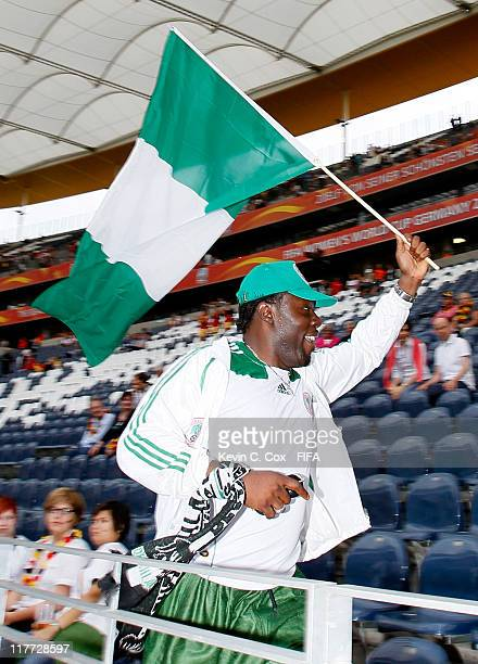 A fan of Nigeria runs through the stands with a Nigerian flag prior to the FIFA Women's World Cup 2011 Group A match between Germany and Nigeria at...