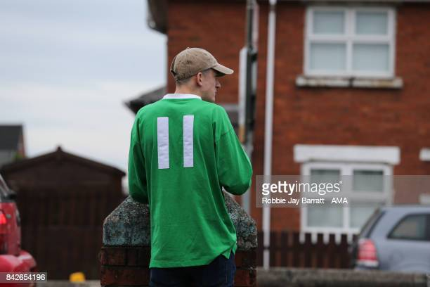 A fan of Northern Ireland wears a number 11 shirt in honour of George Best prior to the FIFA 2018 World Cup Qualifier between Northern Ireland and...