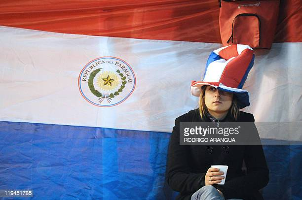 A fan of Paraguay awaits the start of their 2011 Copa America semifinal football match against Venezuela held at the Malvinas Argentinas stadium in...