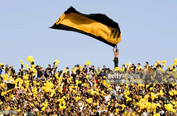 A fan of Penarol waves a flag of his team before the Uruguayan first division derby match against Nacional at the Centenario stadium in Montevideo on...