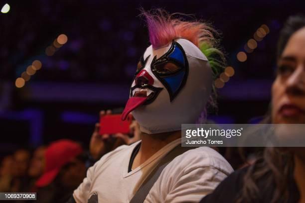 A fan of Psycho Clown wears a wrestling mask during an AAA World Wide Wrestling match on November 16 2018 in Bogota Colombia