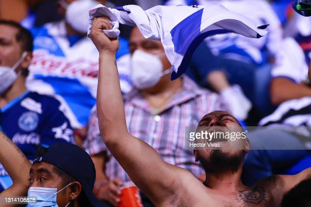Fan of Puebla cheers during the 16th round match between Puebla and Pumas UNAM as part of the Torneo Guard1anes 2021 Liga MX at Cuauhtemoc Stadium on...