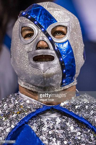 A fan of Puebla sings during the opening friendly match between Puebla and Boca Juniors at Cuauhtemoc Stadium on November 18 2015 in Puebla Mexico