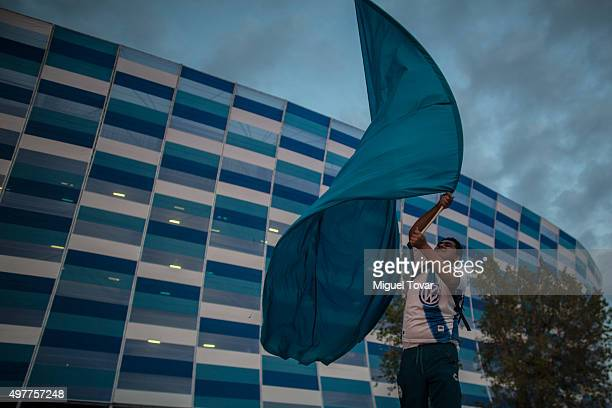 A fan of Puebla waves a flag outside the new Cuauhtemoc Stadium before the opening friendly match between Puebla and Boca Juniors on November 18 2015...