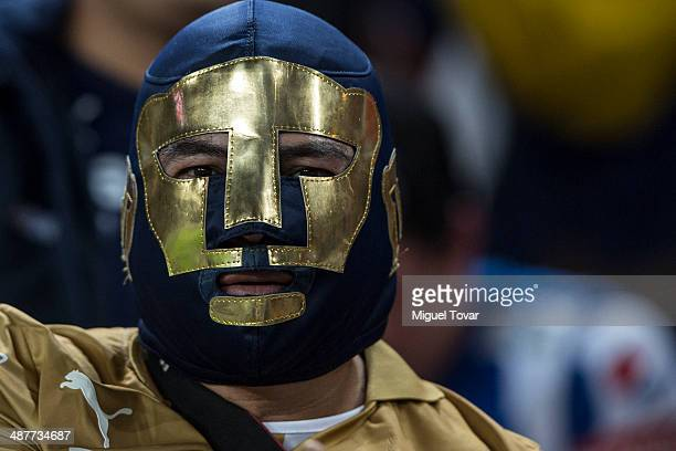 A fan of Pumas looks on during the Quarterfinal first leg match between Pumas UNAM and Pachuca as part of the Clausura 2014 Liga MX Playoffs MX at...