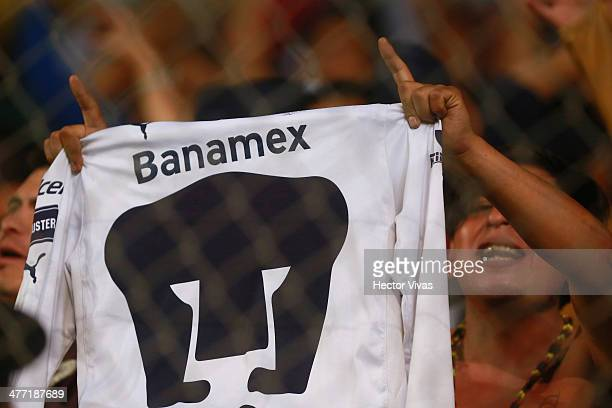 A fan of Pumas show a shirt to suppor his team during a match between Morelia and Pumas UNAM as part of the 10th round Clausura 2014 Liga MX at...