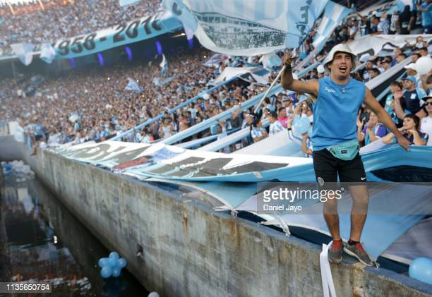 Fan of Racing Club cheers for his team during a match between Racing Club and Defensa y Justicia as part of Superliga 2018/19 at Presidente Peron...