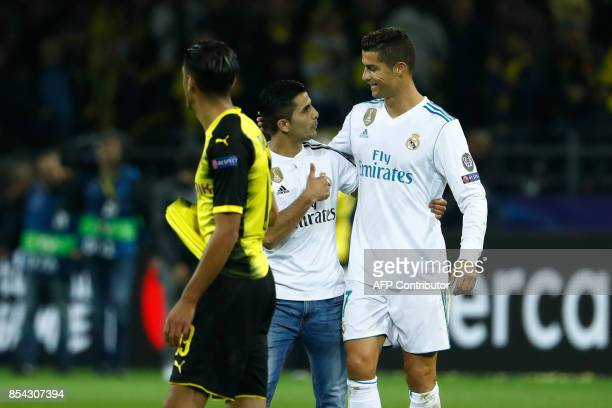 A fan of Real Madrid's forward from Portugal Cristiano Ronaldo after he ran on to embrace his hero after the UEFA Champions League Group H football...