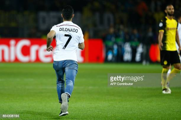 A fan of Real Madrid's forward from Portugal Cristiano Ronaldo runs on the pitch after the UEFA Champions League Group H football match BVB Borussia...