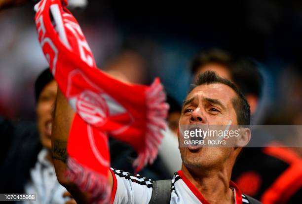 A fan of River Plate cheers at the Santiago Bernabeu stadium in Madrid just hours before the start of the second leg match of the allArgentine Copa...