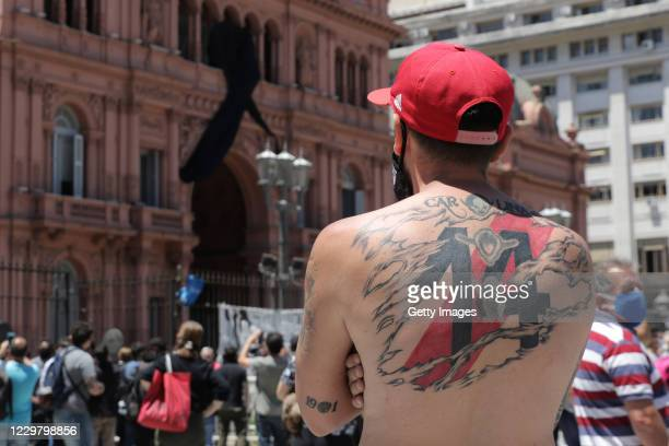 Fan of River Plate looks at the Casa Rosada during Diego Maradona's funeral on November 26, 2020 in Buenos Aires, Argentina. Maradona died of a heart...