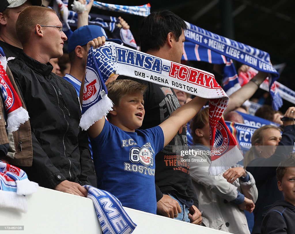A fan of Rostock celebrates during the charity match between Hansa Rostock and FC Bayern Muenchen at DKB-Arena on July 14, 2013 in Rostock, Germany.