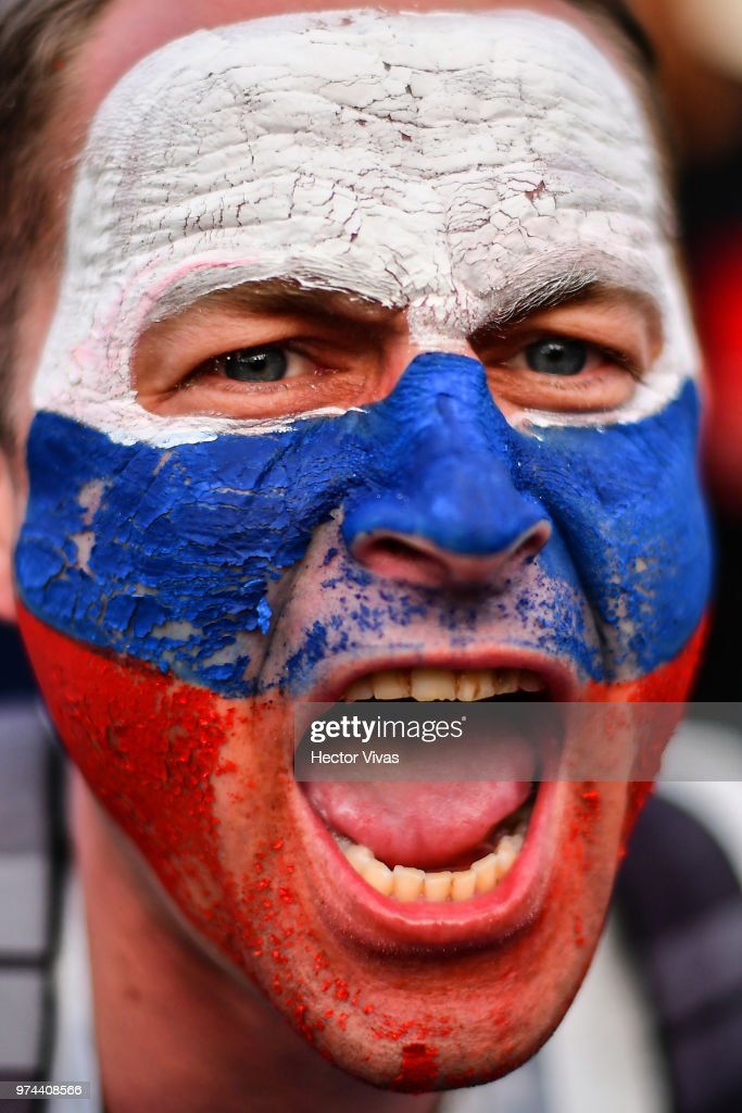 Fan of Russia celebrates after wining the game during the 2018 FIFA World Cup Russia group A match between Russia and Saudi Arabia at FIFA Fans Fest Moscow on June 14, 2018 in Moscow, Russia.