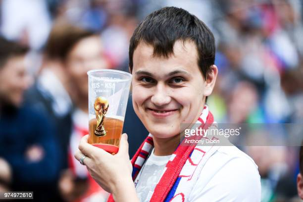 A Fan of Russia with a beer during the 2018 FIFA World Cup Russia group A match between Russia and Saudi Arabia at Luzhniki Stadium on June 14 2018...