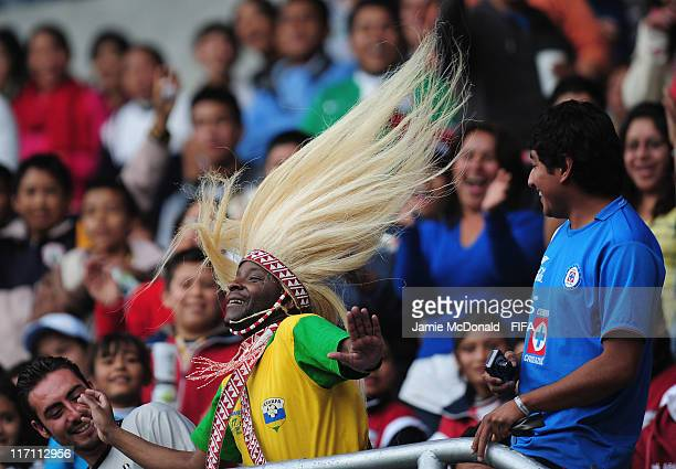 A fan of Rwanda enjoys the game during the FIFA U17 World Cup Group C match between Uruguay and Rwanda at the Estadio Hidalgo on June 22 2011 in...