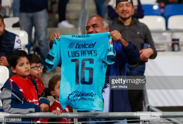 A fan of San Luis shows the jersey of Luis Reyes of San Luis during the 9th round match between Monterrey and Atletico San Luis as part of the Torneo...